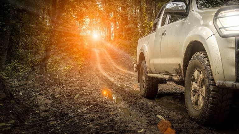 4x4 running down muddy road