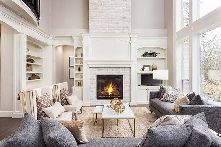 fancy living room with stone fireplace