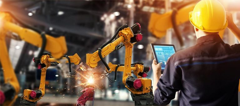 man overseeing automated manufacturing