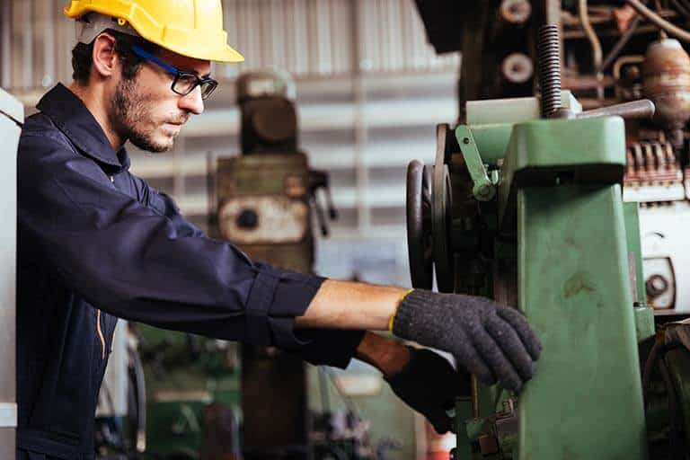 metal worker working at machinery