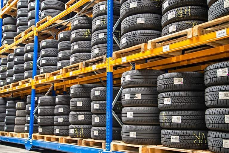 warehouse racking full of car tyres
