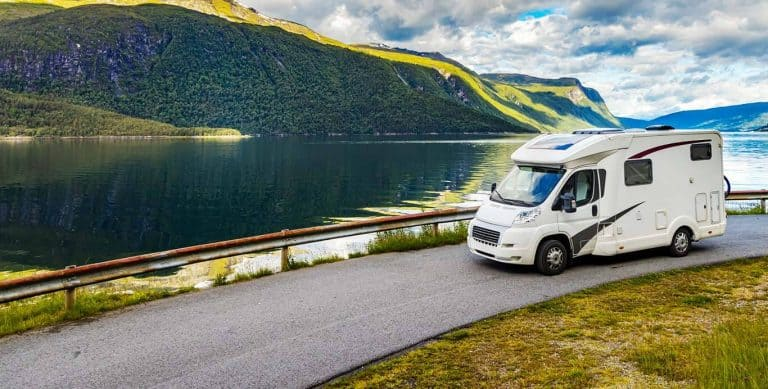 motorhome passing beautiful lake