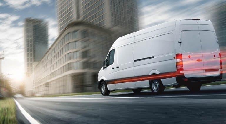 delivery van speeding along road