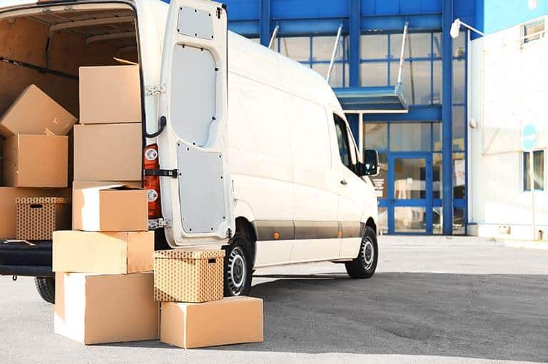 delivery van open at the back with boxes on the floor