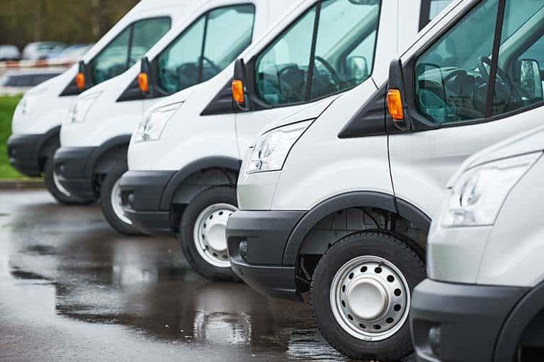 fleet of vans in car park