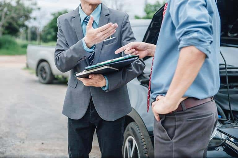 insurance adjuster reviewing data with agent