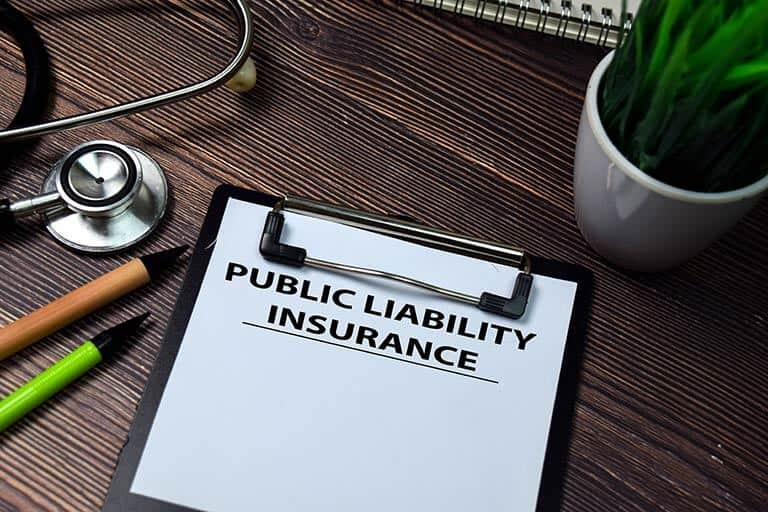 public liability insurance written on clip board