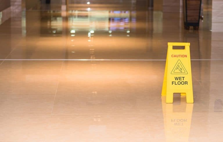 wet floor sign on marble floor