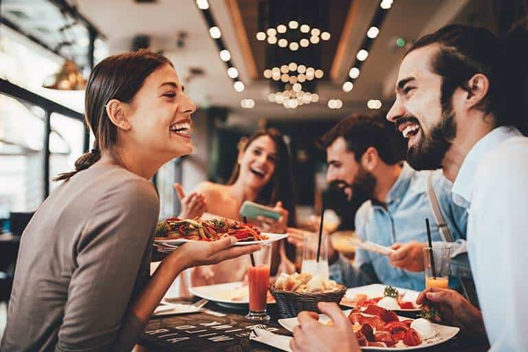 group of friends enjoying a meal in a restaurant