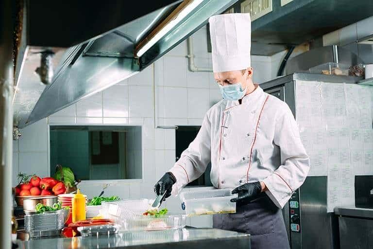 chef preparing food inside kitchen
