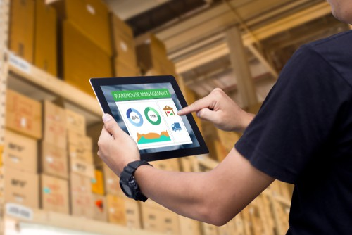 worker using ipad inside warehouse